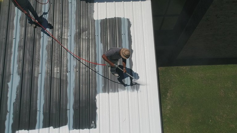 Roof painter at work hobart