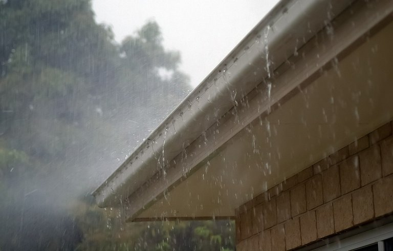 Downpour on hobart roof causing leak in ceiling